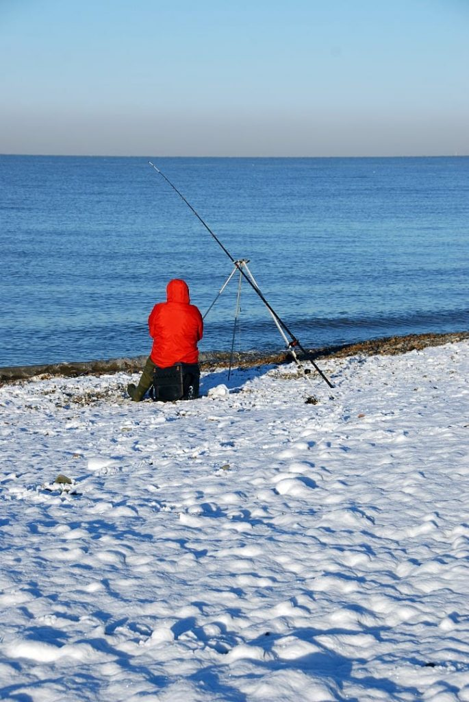 Fishing in the snow at the seaside. Nothing stops the matches at Cleveleys!
