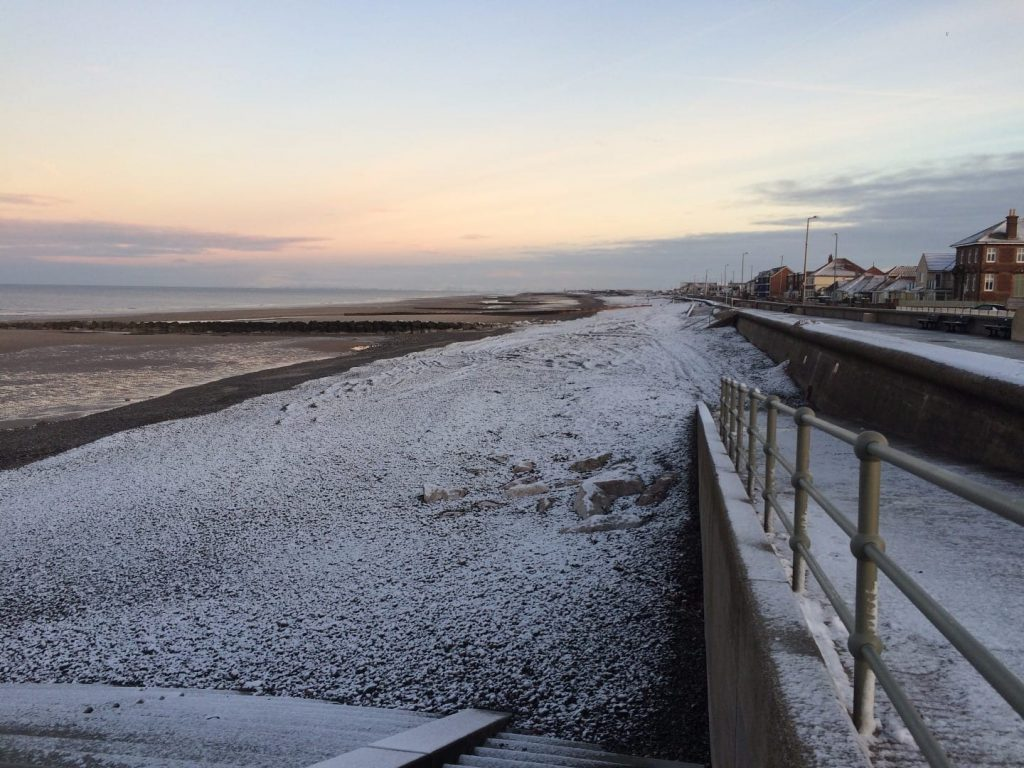 Light dusting of snow at the seaside on Rossall Beach at Cleveleys