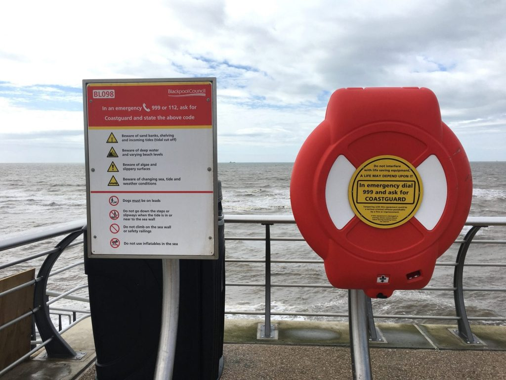 Beach Safety signage and lifebelt