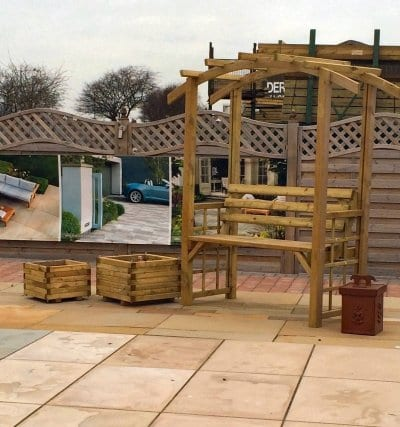 Planters and benches on display at Builders Supplies