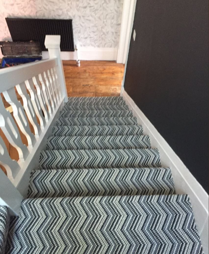 Expert fitting of a complicated stair carpet pattern, from The Carpet Store Poulton