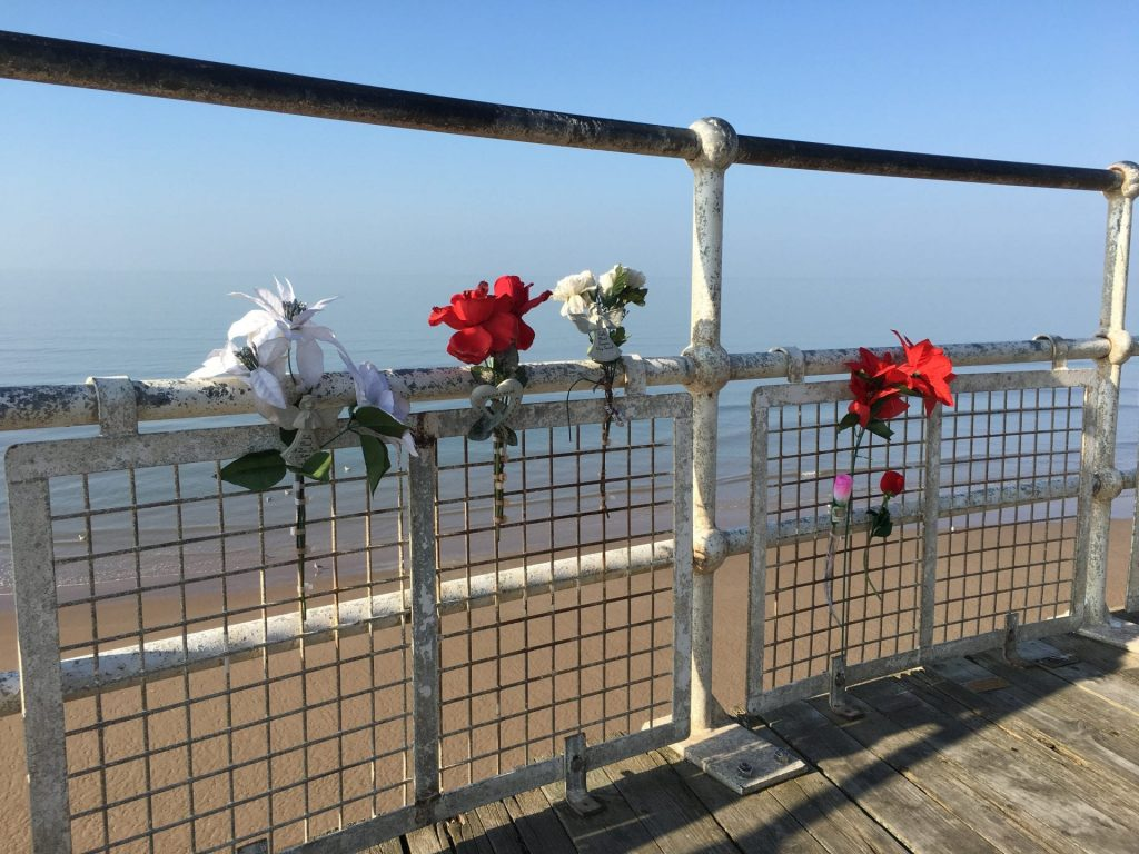 Memorials and flowers at the end of Central Pier