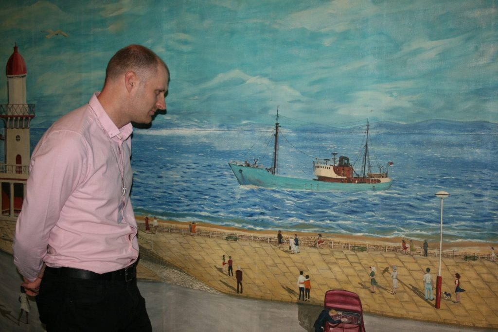 Ben Whittaker from Fleetwood Museum with the Keith Sutton painting