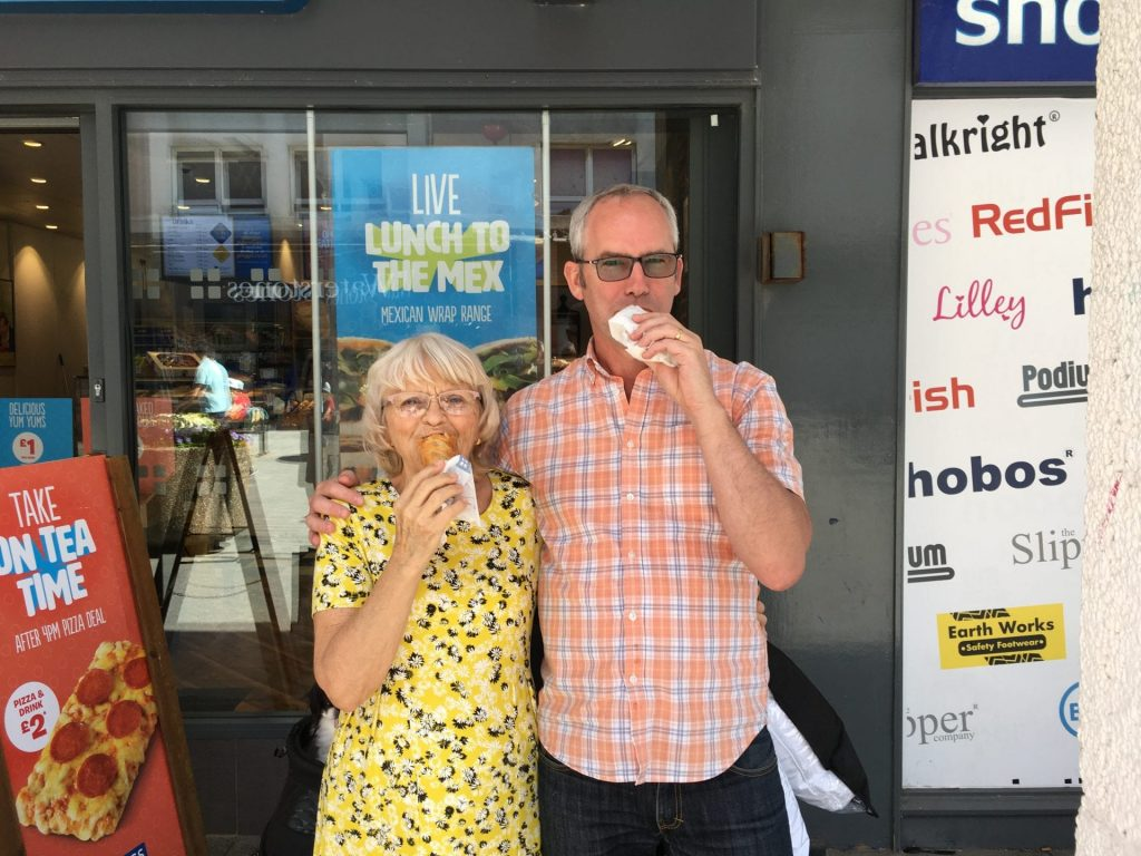 Partners in crime eating sausage rolls
