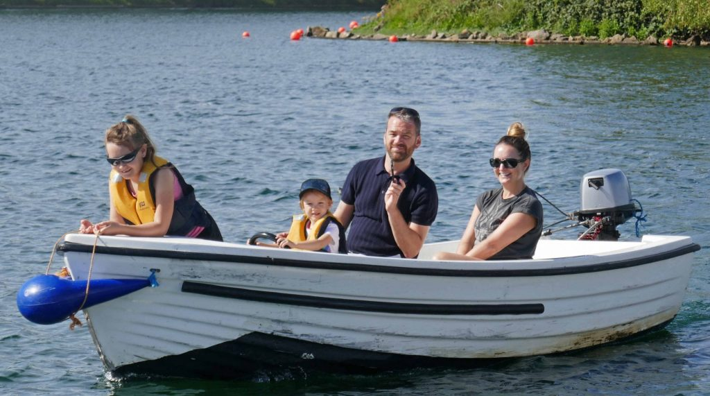 Freya and Lois boating on Fairhaven Lake with mum and dad.